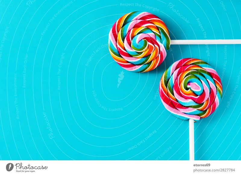 Colorful lollipops on blue background. Top view. Copyspace Lollipop Colour Multicoloured Sugar Candy Sweet Tasty Copy Space Food Food photograph Healthy Eating