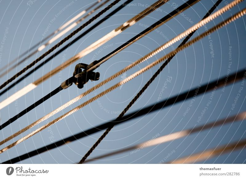 """one always crosses over. Sailing Yacht Sailboat Watercraft Rope Shrouds shackle Blue Gray White """"Graphically,"""" Colour photo Exterior shot Detail Day Light"""