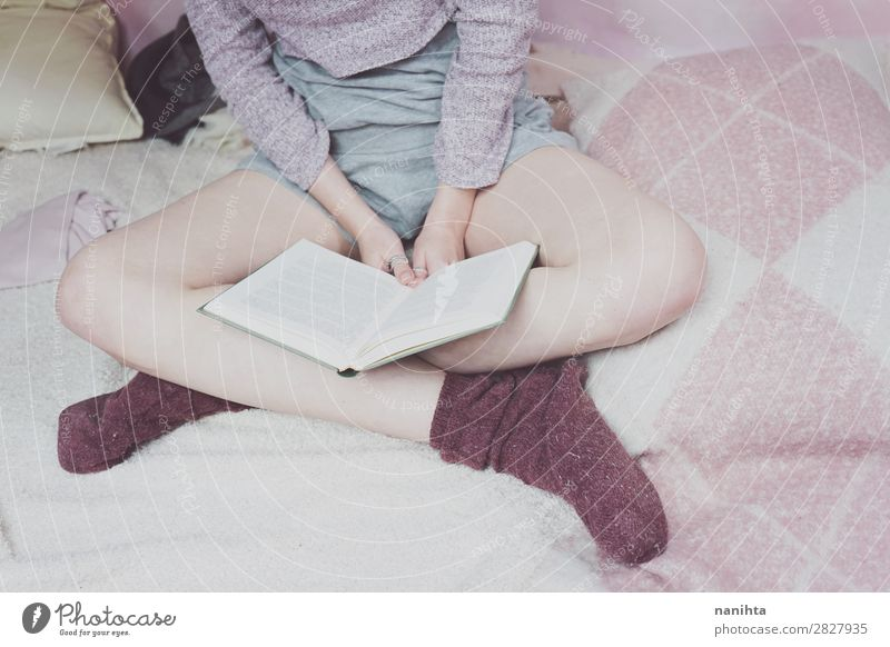 Young woman reading in her bedroom Lifestyle Relaxation Calm Leisure and hobbies Reading Bedroom Education Study Student Feminine Youth (Young adults) Woman