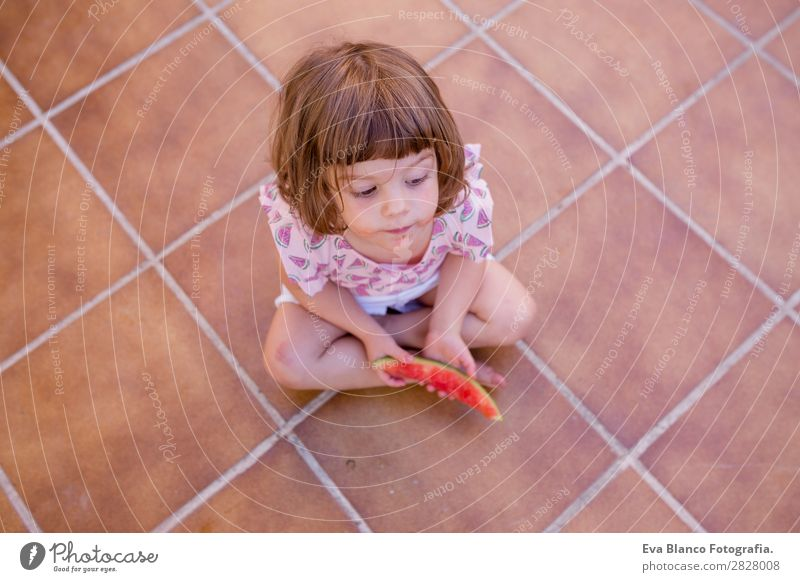 top view of a Beautiful kid girl eating watermelon Fruit Ice cream Eating Joy Happy Vacation & Travel Summer House (Residential Structure) Garden Child Feminine