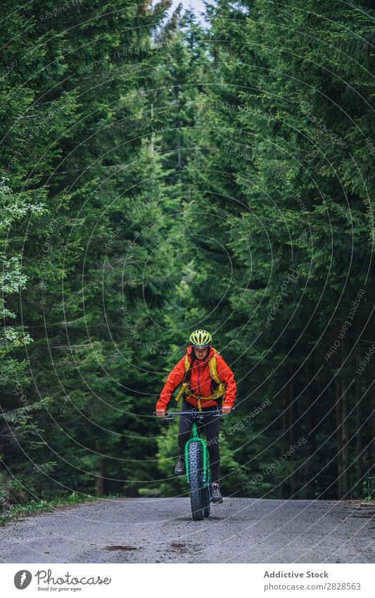 Person riding mountain bike Human being Bicycle Mountain Street Sports Nature Practice Cycling Adventure Motorcycling Lifestyle Relaxation Ride Cycle Action