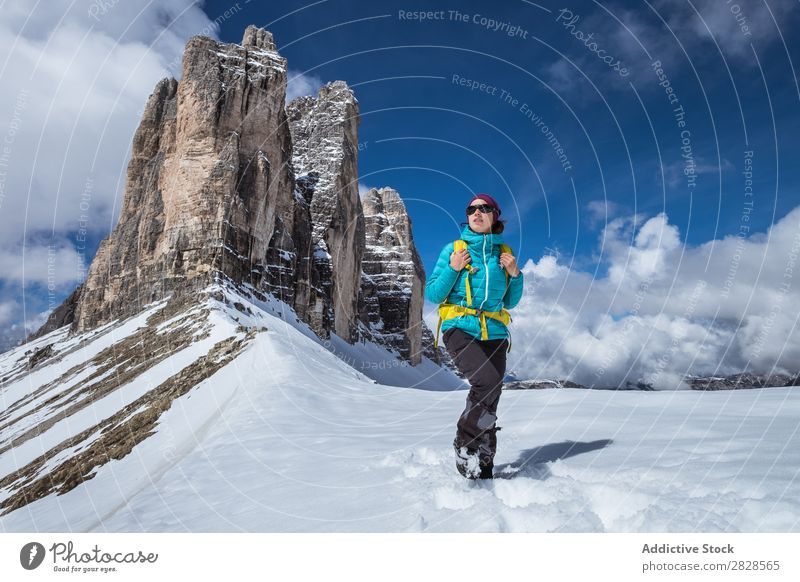 Woman tourist in mountains Snow Mountain Tourist Backpack Looking away Vacation & Travel Winter Hiking Adventure Landscape Nature trekking Extreme hiker