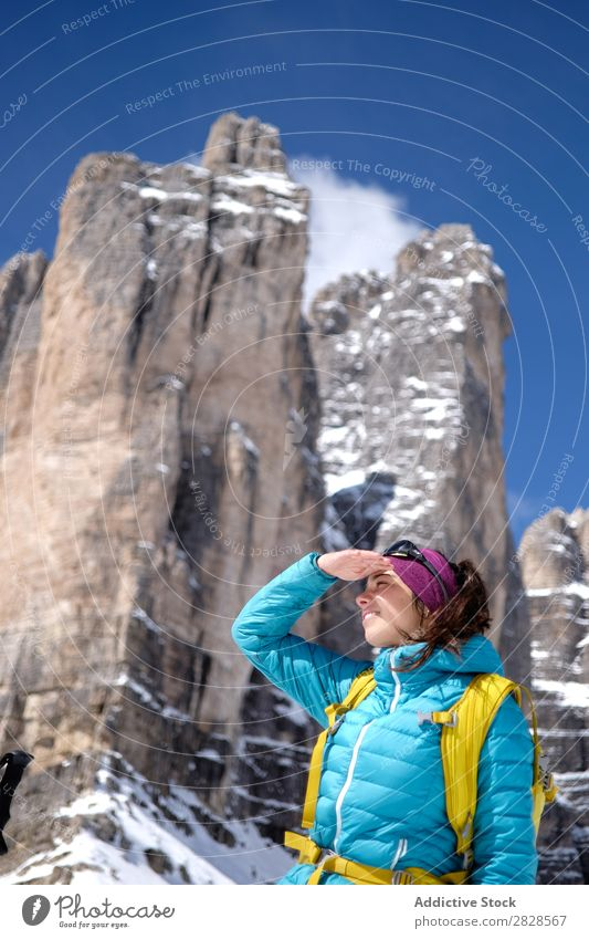 Woman tourist in mountains Snow Mountain Tourist Backpack Looking away Smiling Vacation & Travel Winter Hiking Adventure Landscape Nature trekking Extreme hiker