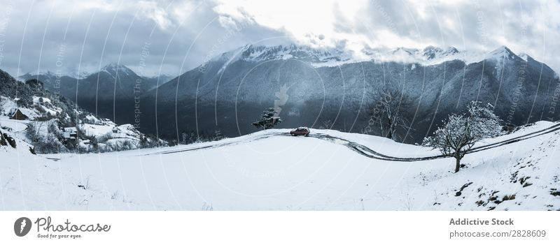 Red car driving in mountains Car Winter Mountain Drive Street Snow Vacation & Travel Cold Ice Weather Transport Landscape Frost Seasons Dangerous Freeze Vehicle
