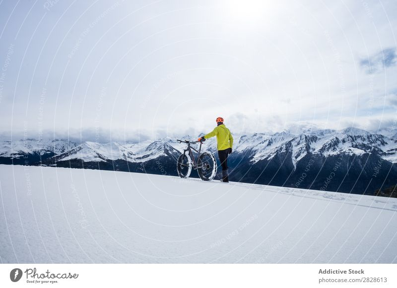 Tourist with bike in mountains Walking Winter Mountain Bicycle sportsman Professional Frozen Nature Hiking Vacation & Travel Landscape Cold Snow Adventure hiker