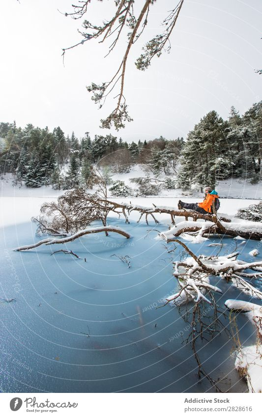 Woman sitting in winter forest Tourist Forest Sit Trunk Winter Lake Frozen Nature Hiking Walking Vacation & Travel Landscape Cold Snow Adventure hiker Lifestyle