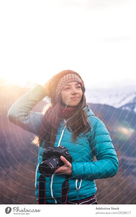 Woman with camera looking away Mountain Winter Photographer Looking away holding head Nature Landscape Vacation & Travel Girl Photography Human being Lifestyle