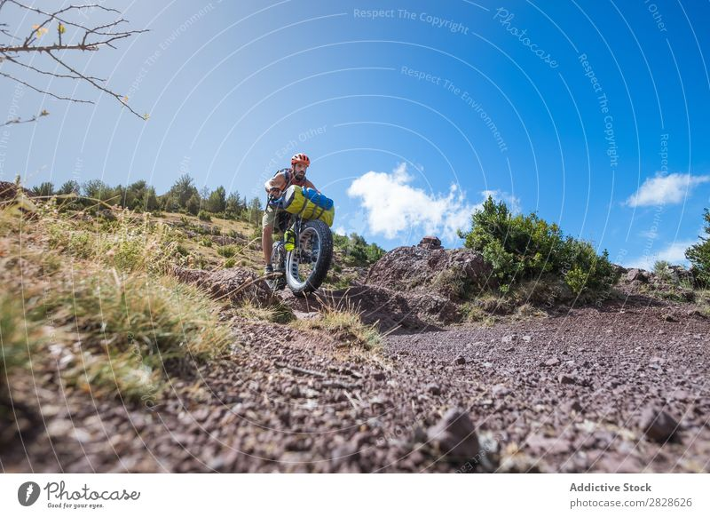 Man riding downhill Tourist Ski-run Ride Sports Vacation & Travel Action Adventure Tourism Mountain Extreme Street Motorcycling Bicycle Nature Cycle Relaxation