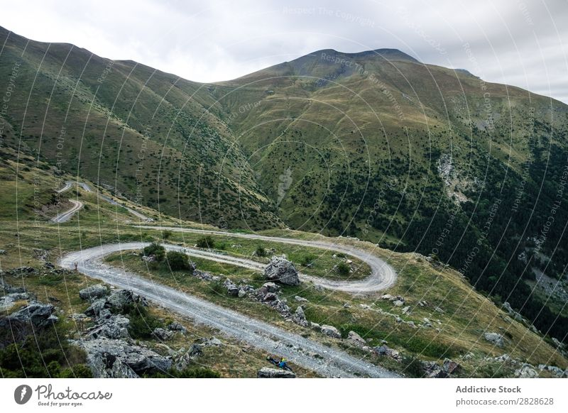 Curvy road in mountains Valley Mountain Street serpentine Landscape Panorama (Format) Mysterious Rural Vantage point Curved Tourism Vacation & Travel Nature
