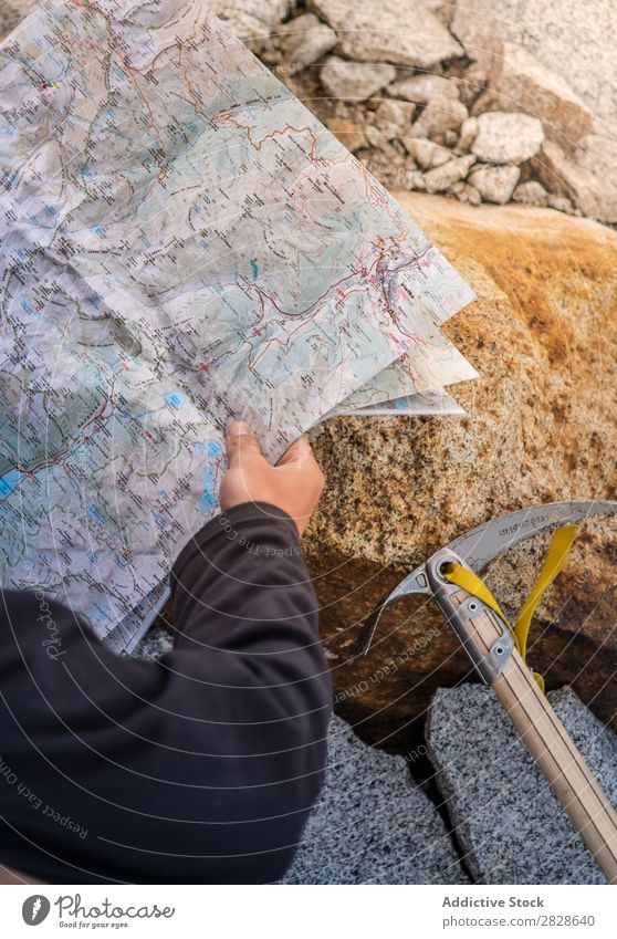 Tourist with map on stone Map navigating Stone Axe ice-axe Vacation & Travel Nature Trip Adventure Navigation Tourism Hiking Rock Direction Mountain Lifestyle