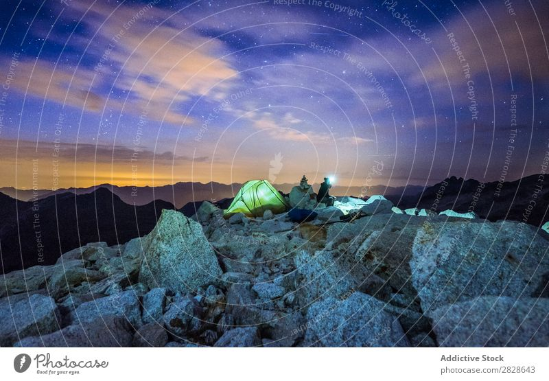 People in camp at night Human being Mountain Camping Tent Vacation & Travel Nature Night Illumination Light starry Sky Landscape Adventure Hiking Tourism Action