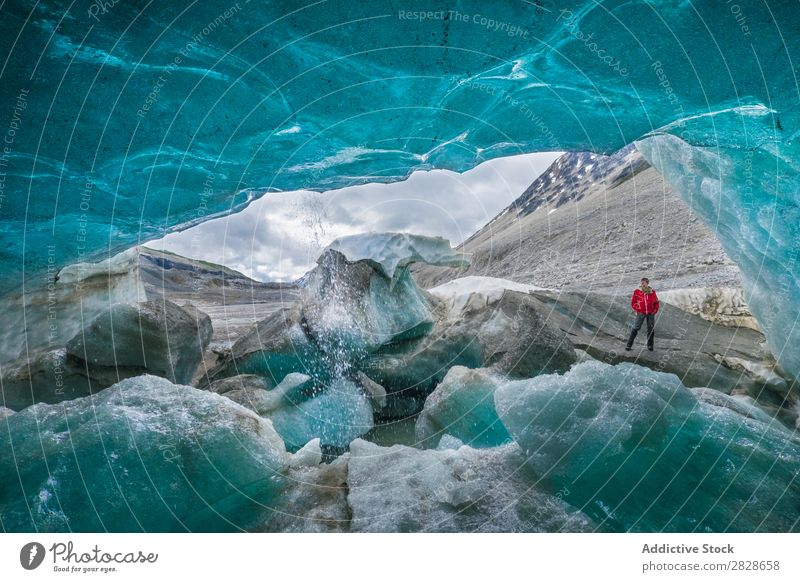 Inside of ice cave and traveler outside Cave Ice Coast Human being Posture Traveling Adventure Formation national Glacier Rock Clear scenery Interior shot