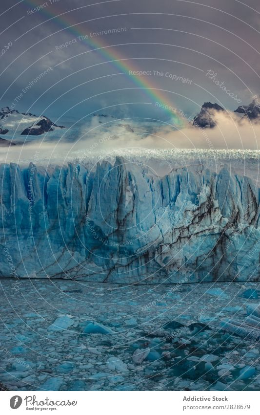 Rainbow above glacier Glacier Landscape Natural Wilderness Cloud cover Tourism Phenomenon Beauty Photography Forest snows Highlands Vacation & Travel Nature