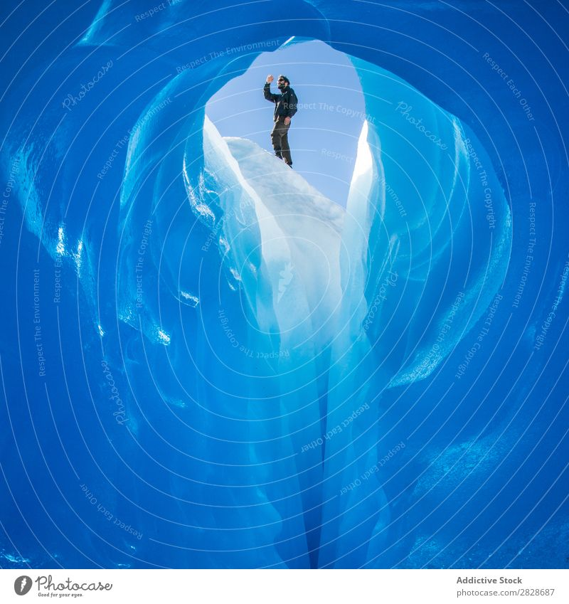 Person on top of ice cave Tourist Glacier Cave Ice Landscape Crystal Tourism Interior shot Natural Attraction Cold The Arctic Extreme Adventure Entrance Freeze