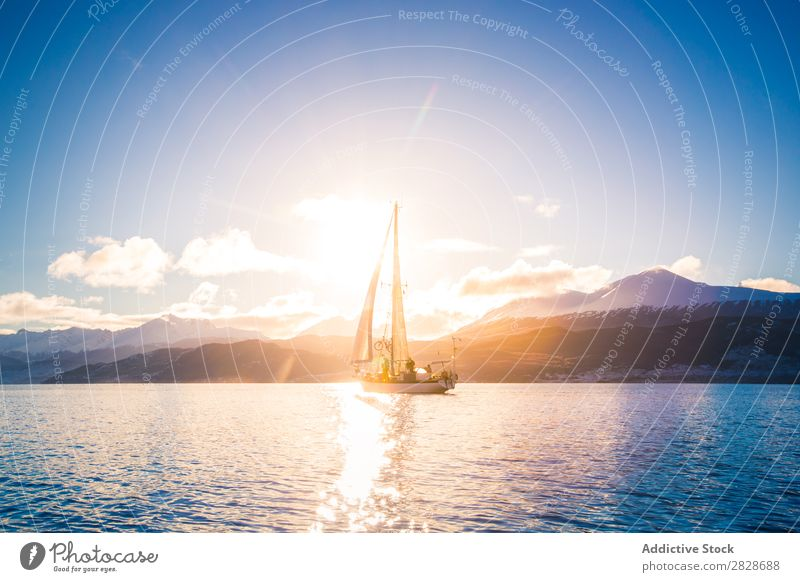 Sailboat in sea on background of mountains Landscape Floating Mountain Vessel Yachting Flow Transport Ocean Blue Adventure Vacation & Travel Nautical Water