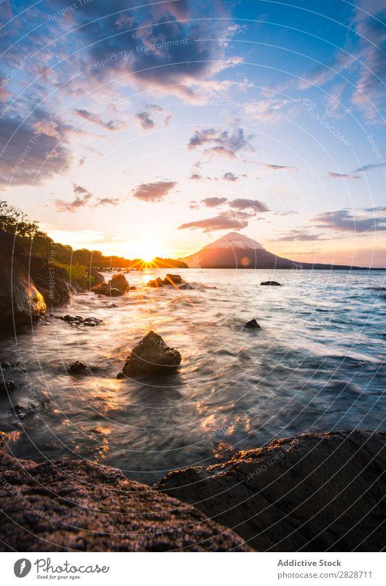 Picturesque view of rocks on ocean shore Landscape Ocean Rock Coast Sunset Tropical seaside Bright Wilderness seascape Evening Virgin forest Nature Beach