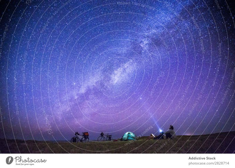 People watching starry sky while camping Couple Tourism Stars Observe Traveling Universe Bicycle Adventure