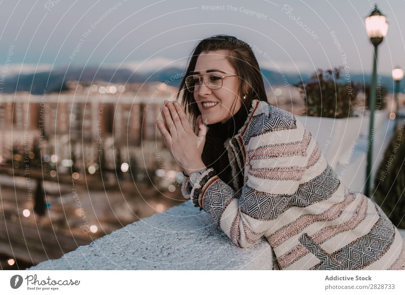 Cheerful young woman leaning on fence Woman pretty Youth (Young adults) Beautiful Fence Lean Town Street Smiling Person wearing glasses Brunette Attractive