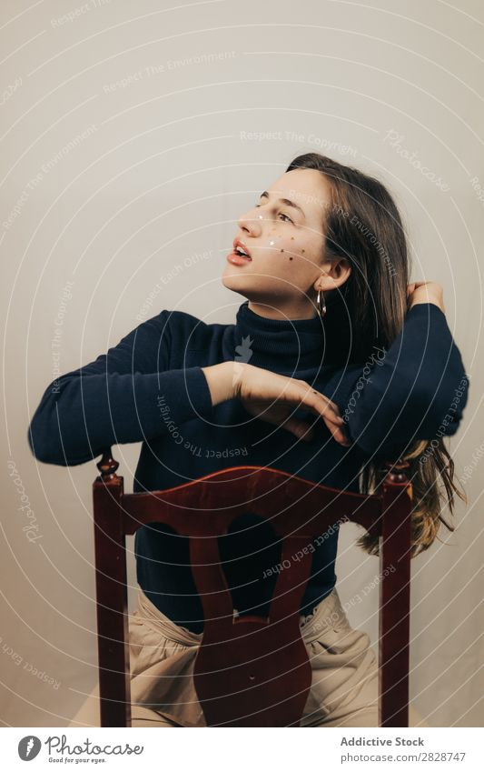 Smiling woman sitting on chair Woman pretty Youth (Young adults) Sit Beautiful Cheerful Chair glitters Face Brunette Attractive Human being Beauty Photography