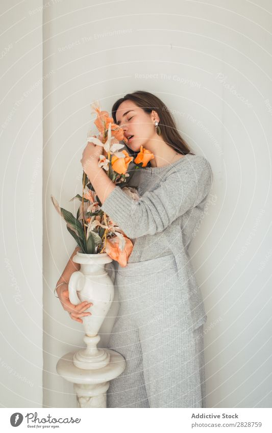 Sensual woman embracing flowers Woman pretty Youth (Young adults) Beautiful Flower Orange Vase Stand To enjoy eyes closed Brunette Attractive Human being