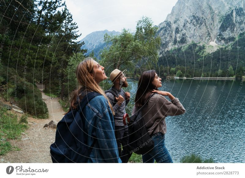 Happy friends in mountains Woman Man Mountain Joy Posture Together Hiking Lake Water Cheerful Vacation & Travel Adventure Tourist Youth (Young adults) Nature