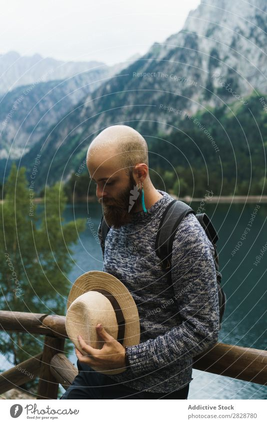 Handsome tourist at mountain lake Tourist Man Lake handsome bearded Nature Fence Wood Vacation & Travel Lifestyle Backpack Mountain Landscape Water