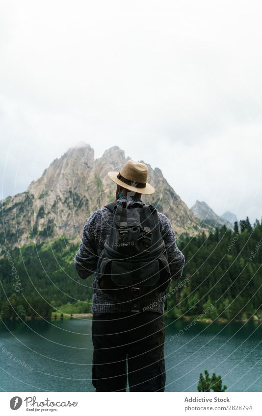 Man screaming in mountains Tourist Lake handsome bearded Nature Scream hands to mouth Freedom Vacation & Travel Lifestyle Backpack Mountain Landscape Water