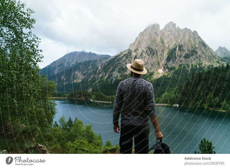 Man posing in mountains Tourist Lake handsome bearded Nature Freedom Vacation & Travel Lifestyle Backpack Mountain Landscape Water Youth (Young adults) Hiking