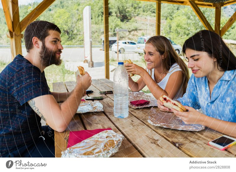 Cheerful friends having meal while traveling Human being Friendship Traveling Vacation & Travel Café Adventure Eating