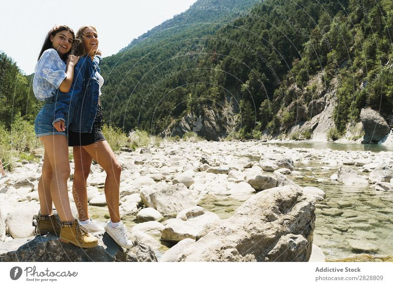 Cheerful girlfriends on nature Woman Summer Mountain Tourism Freedom lgbt Rock Youth (Young adults) Couple Happiness Stream Nature Exterior shot Together