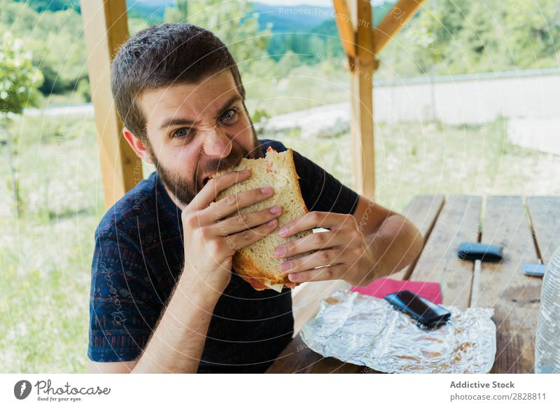 Expressive man with sandwich Man Eating Anger pretend having fun Appetite Crazy Posture facial Intellect Playful Youth (Young adults) bearded Human being