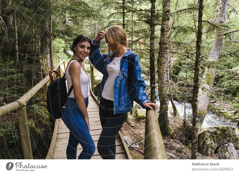 Pretty women standing on bridge Woman Bridge Wood Nature Human being Summer Water Beautiful Beauty Photography Vacation & Travel Happiness Youth (Young adults)