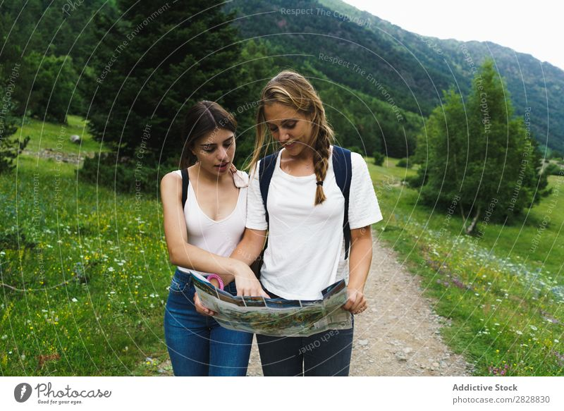 Women with map on mountain road Woman Street Mountain Walking Hiking Vacation & Travel Adventure Tourist Backpack Youth (Young adults) Nature Trip