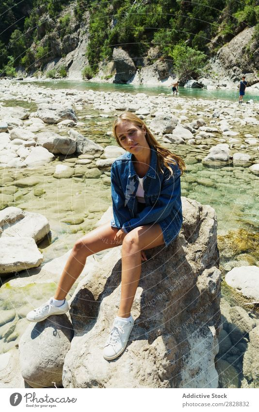 Woman sitting on rocks Summer Mountain Tourism Freedom Rock Happiness Stream Nature Exterior shot Cheerful Vacation & Travel Beautiful Exotic Relaxation