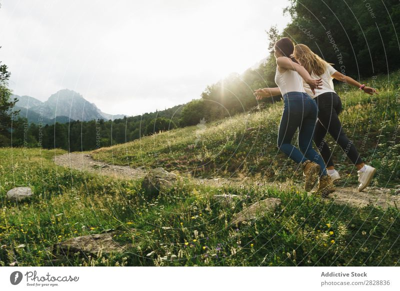 Cheerful women running on mountain road Woman Street Rural Friendship Backpack Nature Walking Girl Youth (Young adults) Beautiful Vacation & Travel Tourism Trip