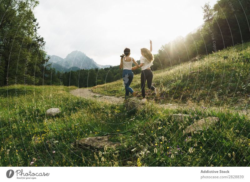 Cheerful women running on mountain road Woman Walking Street Rural Friendship Backpack Nature Girl Youth (Young adults) Beautiful Vacation & Travel Tourism Trip