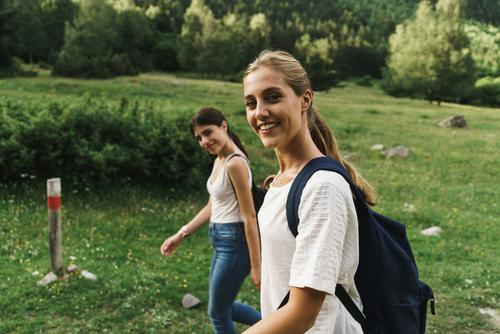 Women walking on nature Woman Walking Rural Friendship Backpack Nature Girl Youth (Young adults) Beautiful Vacation & Travel Tourism Trip Human being Tree Park
