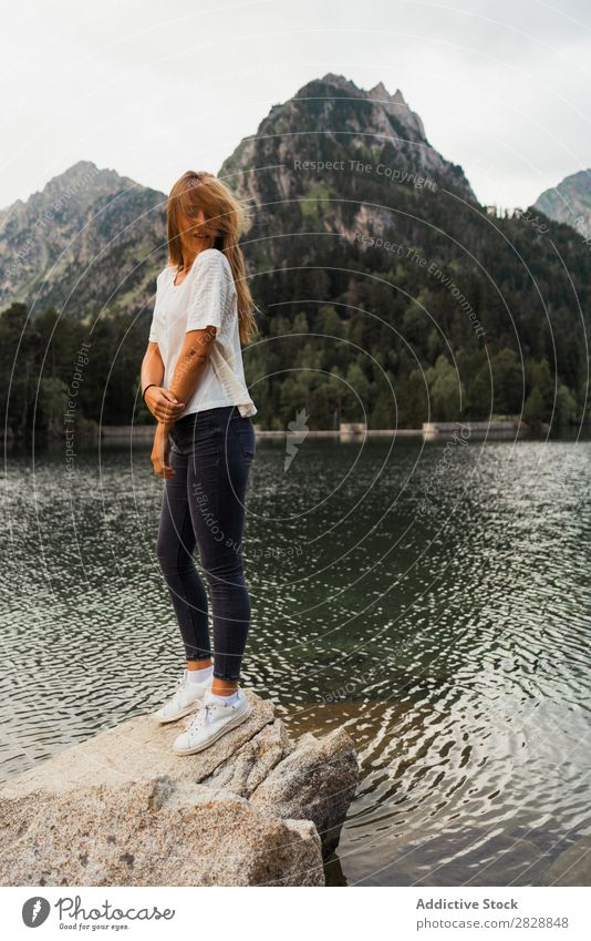 Woman sitting on stone at lake Stone Lake Mountain Nature Landscape Water Rock Beautiful Youth (Young adults) Hiking Vacation & Travel Adventure Trip trekking