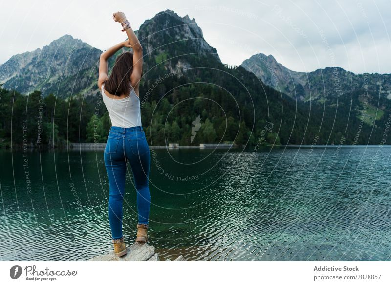 Woman standing on stone at lake Stone Lake Mountain Nature Landscape Water Rock Beautiful Youth (Young adults) Hiking Vacation & Travel Adventure Trip trekking