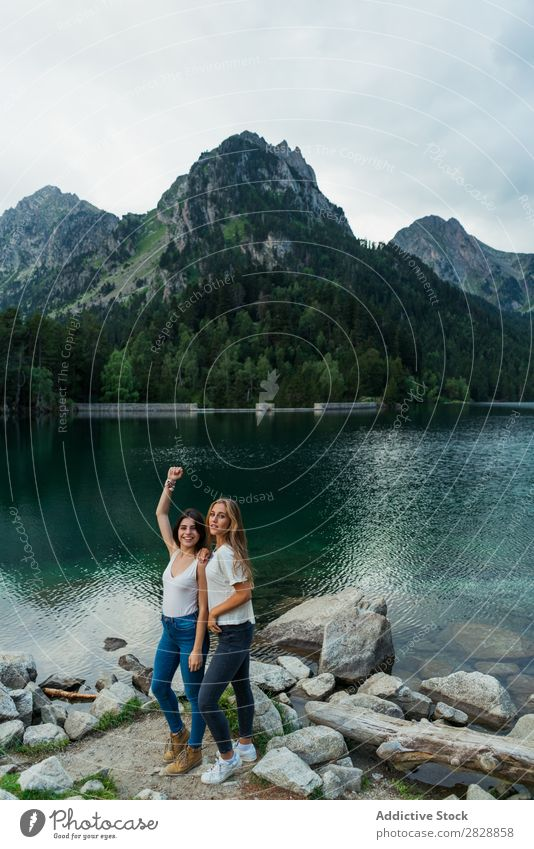 Women at lake in mountains Woman Mountain Walking Hiking Lake Water embracing Smiling Cheerful Happy Vacation & Travel Adventure Tourist Youth (Young adults)