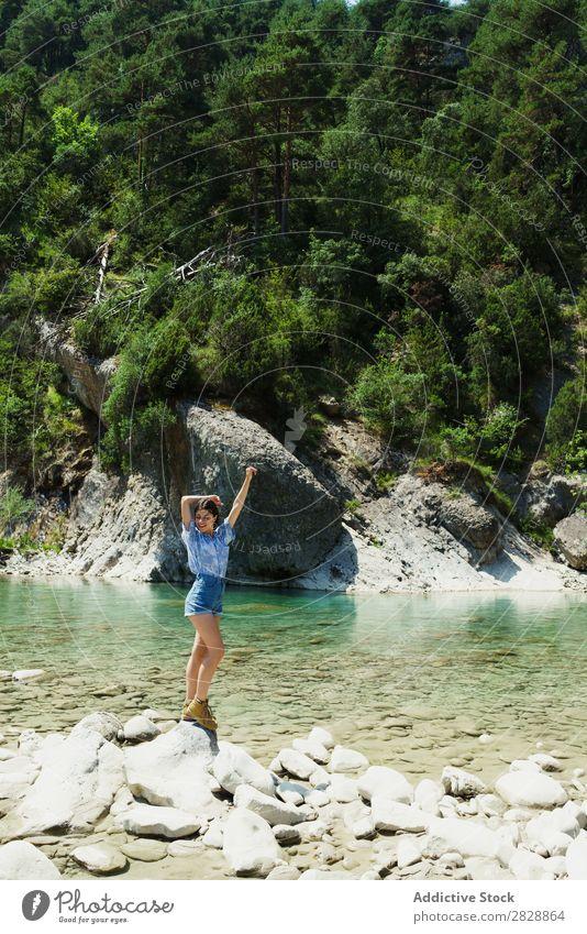 Woman posing on tropical stream Posture traveler trekking Tropical Mountain Rock Paradise Hiking enjoyment Tourism River Summer pose Hands up! Lanes & trails