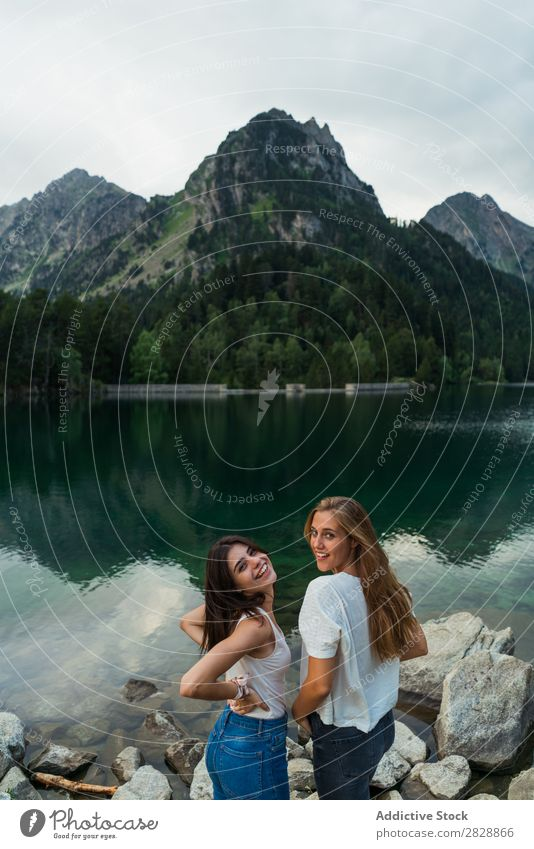 Women at lake in mountains Woman Mountain Walking Hiking Lake Water Smiling Cheerful Happy Vacation & Travel Adventure Tourist Youth (Young adults) Nature Trip
