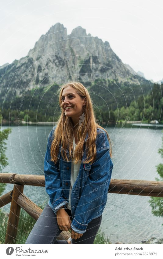 Woman posing at lake in mountains Mountain Smiling Cheerful Happy Hiking Lake Water Vacation & Travel Adventure Tourist Youth (Young adults) Nature Trip