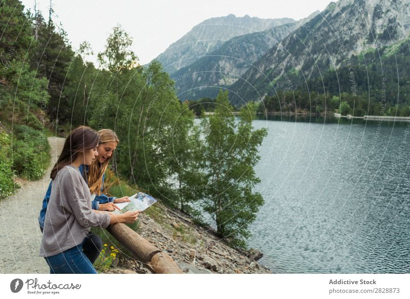 Women with map on mountain road Woman Street Mountain Walking Hiking Vacation & Travel Adventure Tourist Youth (Young adults) Nature Trip Leisure and hobbies