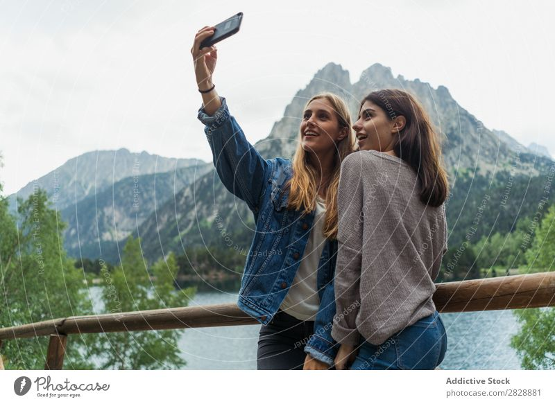 Women taking selfie on mountain road Woman Street Mountain Walking Hiking Vacation & Travel Adventure Tourist Youth (Young adults) Nature Trip