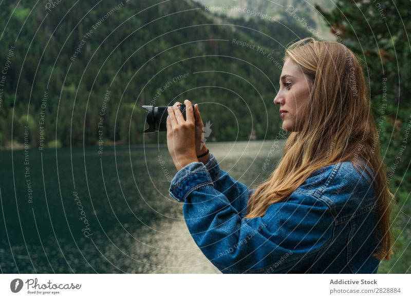 Woman taking shots on mountain lake Photographer Lake Mountain Camera Nature Landscape Water Beautiful Youth (Young adults) Hiking Vacation & Travel Adventure