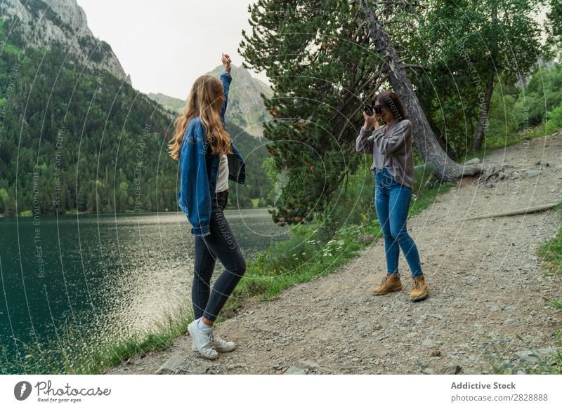 Women with camera in mountains Woman Mountain Walking Camera Photographer Posture Lake Water Take Together Smiling Hiking Cheerful Happy Vacation & Travel