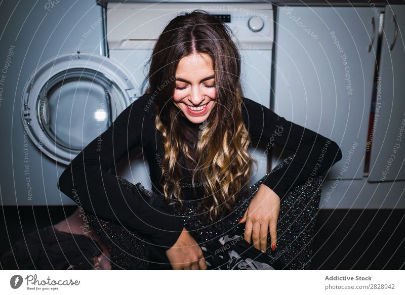 Woman sitting at laundry machine pretty Posture Home Laundry Clothing Sit Kitchen Smiling Beautiful Lifestyle Youth (Young adults) Human being Happy Attractive