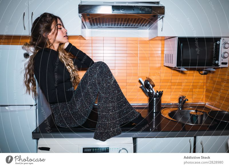 Woman sitting on kitchen table pretty Posture Home Sit Table Kitchen Beautiful Lifestyle Youth (Young adults) Human being Happy Attractive Portrait photograph