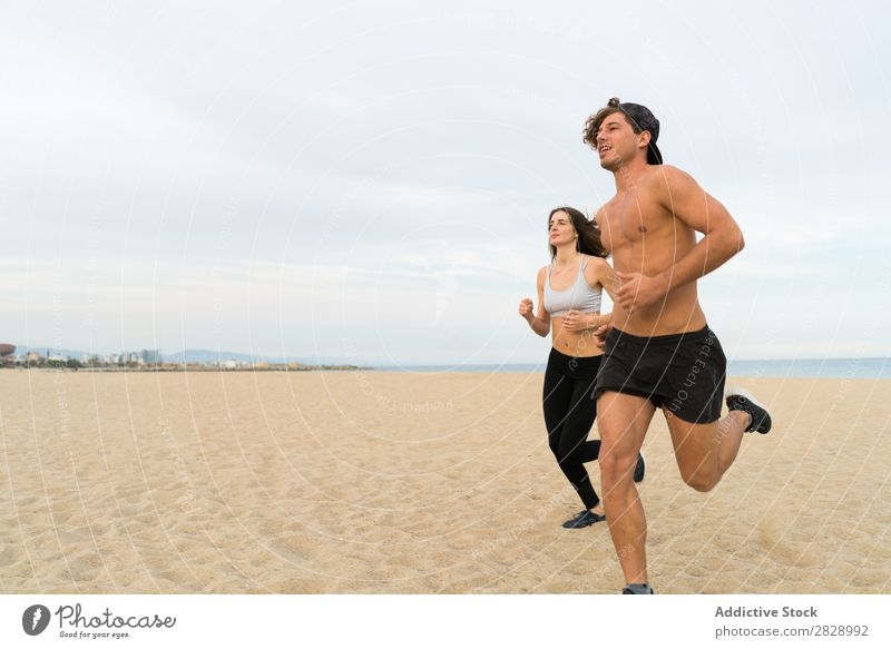 Two sportsmen running on beach Couple Beach Running Sports Human being Athletic workout Coast Action Jogging Fitness Runner Together Speed Exterior shot